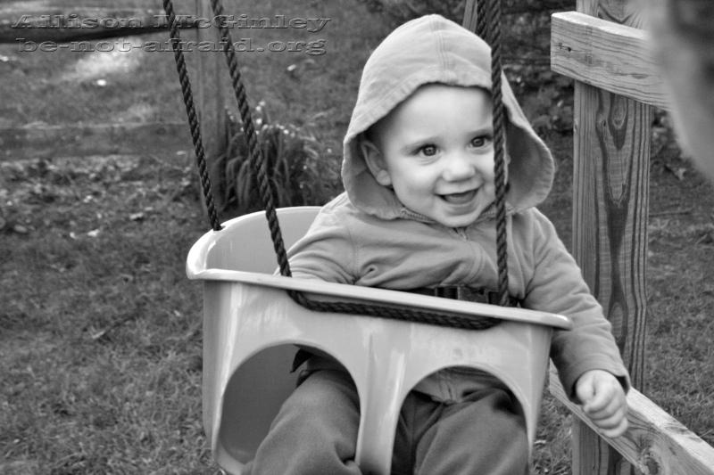 Happy baby on swing